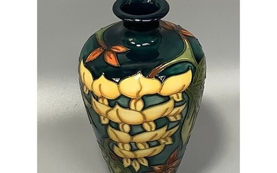 A Moorcroft Collectors Club pottery vase of baluster form an...