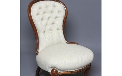 A VICTORIAN WALNUT SALON CHAIR of spoonback form button upho...