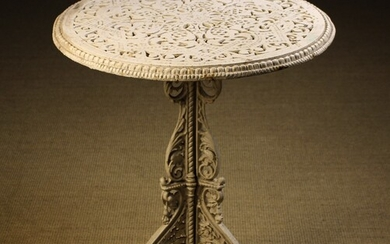 A Victorian Coalbrookdale Cast Iron Table designed by Christopher Dresser. The decoratively pierced circular top...
