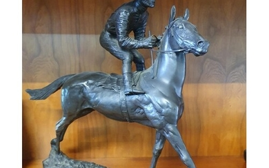 A bronzed figure of a Racehorse with Jockey up. H30 x D6 x W...