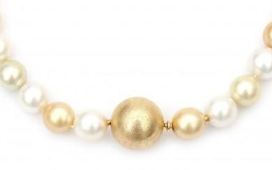 A multi colour single strand South Sea pearl necklace to an 18 carat gold clasp. Featuring thirty four cultured gold and white coloured South Sea pearls strung to a ball shaped bayonet clasp. Gross weight: 104.4 g.
