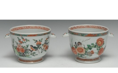 A pair of Chinese famille verte ice pails, painted in polych...