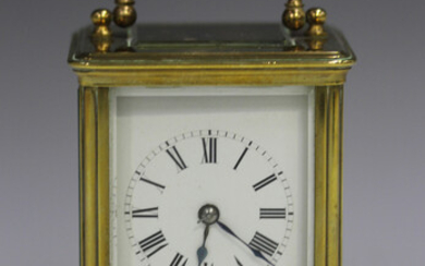 An early 20th century French brass cased diminutive carriage clock by Richard & Cie, with eight