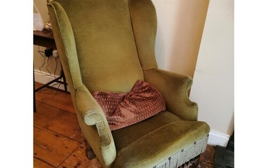 Early 20th. C. upholstered wing backed armchair. { 105cm H X...