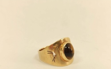 Gold ring with tigers eye cabochon and pierced gazelle shoul...
