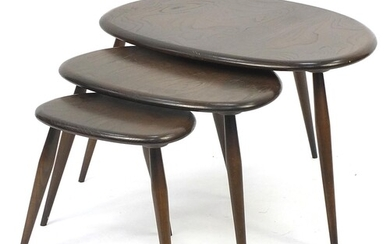 Nest of three Ercol elm Pebble occasional tables, the larges...