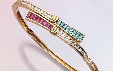 18 kt gold bangle with coloured stones...