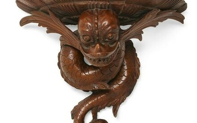 A Baroque style dolphin form wall bracket