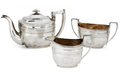 A George III Scottish silver three-piece tea set, Edinburgh, c.1808, probably William Auld, of rectangular form with bright-cut engraved floral bands to body above vacant cartouches, the teapot with angular silver handle and silver finial to lid...