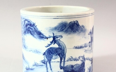 A LARGE CHINESE BLUE AND WHITE BRUSH POT, decorated with dee...
