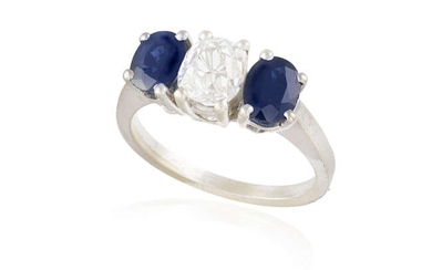 A SAPPHIRE AND DIAMOND THREE-STONE RING The central...