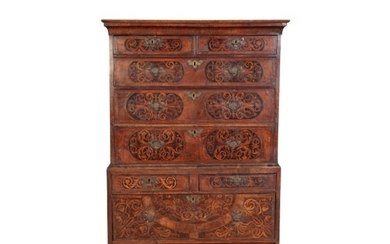 A WILLIAM AND MARY WALNUT AND SEAWEED MARQUETRY CHEST ON CHE...