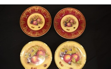 A collection of Aynsley Orchard Gold plates with D Jones sig...