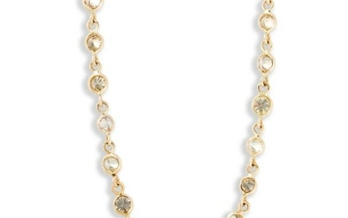 A colored diamond and fourteen karat gold necklace