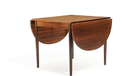 NOT SOLD. Danish furniture design: A Brazilian rosewood dining table with two foldable D-ends. H....