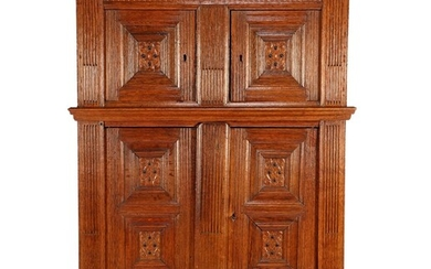 (-), Oak Renaissance richly decorated 4-door cabinet with...