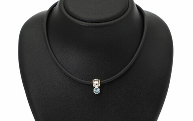 Georg Jensen: An aquamarine necklace of black rubber with a pendant set with an aquamarine, mounted in 18k white gold and gold. (2) – Bruun Rasmussen Auctioneers of Fine Art