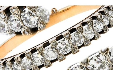 IMPORTANT DIAMOND HINGED BANGLE, set with a central row of l...