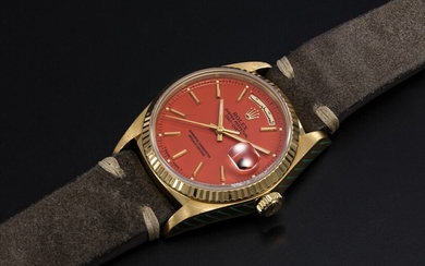 ROLEX, A GOLD OYSTER PERPETUAL DAY-DATE WITH ORANGE STELLA DIAL AND ARABIC CALENDAR, REF. 18038