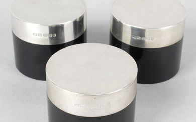 Three circular boxes with silver mounted lids.