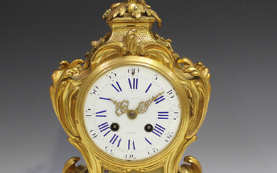 A 19th century French ormolu mantel clock with eight day movement striking hours and half hours on a