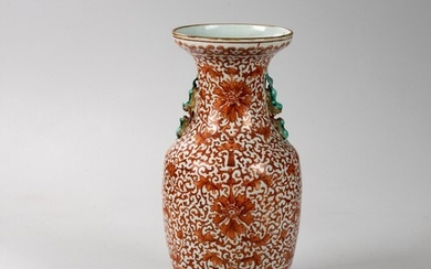 A CHINESE IRON-RED 'BAT, LOTUS AND MUSICAL STONE' VASE, QING...