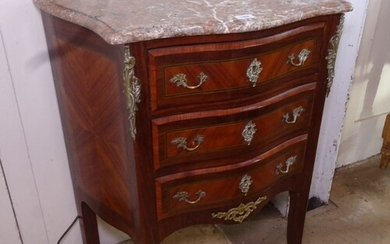 A French kingwood serpentine-front commode, with shaped marb...