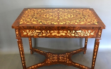 A French style marquetry inlaid rectangular centre table, th...