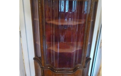 A French style serpentine fronted glazed display cabinet, th...