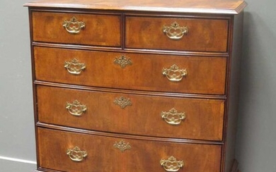 A George III walnut bow front chest of two short over three graduating long drawers on later pad