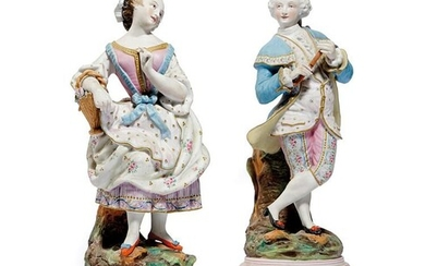 A PAIR OF CONTINENTAL BISCUIT PORCELAIN FIGURES LATE 19TH CENTURY of a well dressed gentleman...