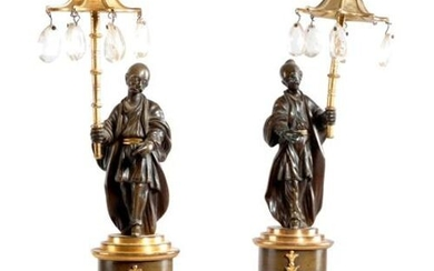 A PAIR OF REGENCY GILT AND PATINATED BRONZE FIGURAL CANDLESTICKS...