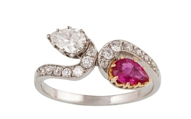A RUBY AND DIAMOND RING, of cross over design, set with pear...
