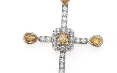 NOT SOLD. A diamond pendant set with numerous Fancy Orangy Yellow and white diamonds weighing...