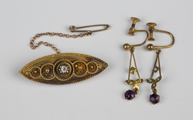 A late Victorian gold and diamond single stone brooch of boat shape form, mounted with a cushion sha
