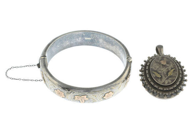 A late Victorian silver floral locket and a mid 20th century silver floral bangle.