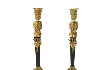 A pair of 19th century Russian gilt and partly patinated bronze candlesticks. H. 34.5 cm....