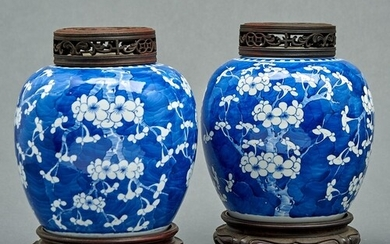 A pair of Chinese blue and white prunus-on-cracked-ice jars,...