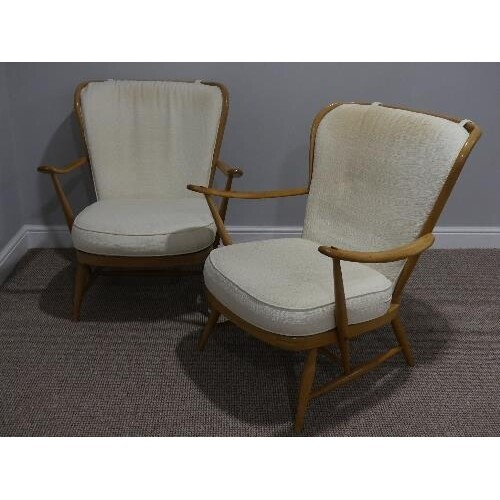 A pair of mid 20thC Ercol beech spindle back Easy Chairs, Mo...