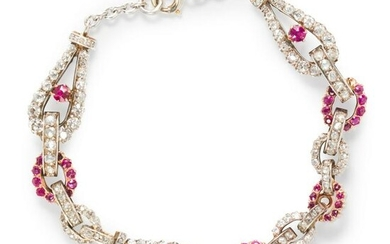 A ruby, diamond and silver-topped eighteen karat gold