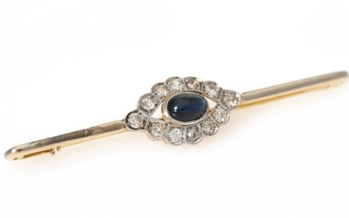 NOT SOLD. A sapphire and diamond brooch set with a synthetic sapphire encircled by numerous diamonds, mounted in 18k gold and platinum. L. app. 6.2 cm. – Bruun Rasmussen Auctioneers of Fine Art