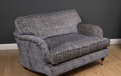 A small modern deep two seater sofa