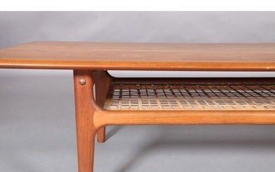 A teak crossbanded coffee table, rectangular, with wicker un...