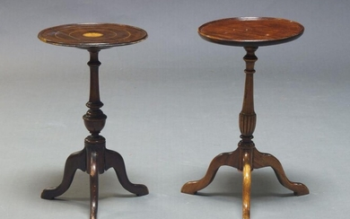 An Edwardian mahogany and inlaid wine table, the circular top centred by fan motif, on turned support to tripod legs, 49cm high, 29cm diameter, together with another mahogany wine table, 50cm high, 28cm diameter (2)