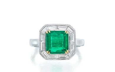 An Emerald, Diamond, and White Gold Ring