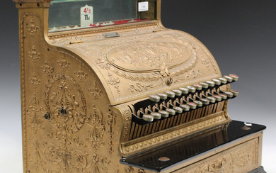 An early 20th century gilt painted cast metal National cash register, bearing serial number plaque &