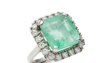 An emerald and diamond set cluster ring