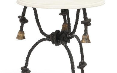 A 20th century round café table with cast iron base in shape of rope with tassels. H. 77. Diam. 71 cm. – Bruun Rasmussen Auctioneers of Fine Art