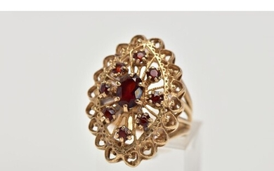 A 9CT GOLD GARNET DRESS RING, of a large openwork marquise s...