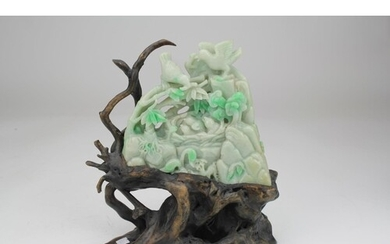 A Chinese Jade carved Bolder ornament designed as a nest of ...